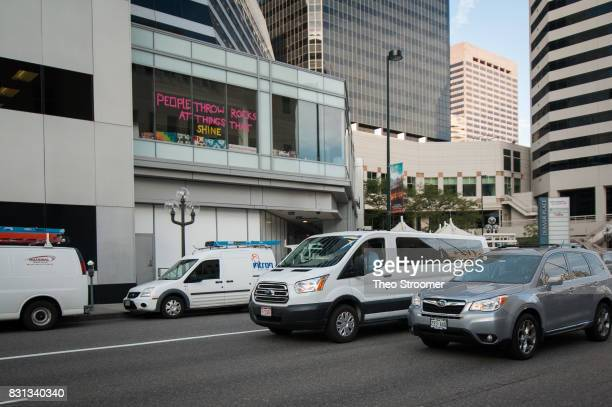 A van purportedly carrying Taylor Swift passes a sign with a lyric from the Swift song Ours before the civil case for Taylor Swift vs David Mueller...