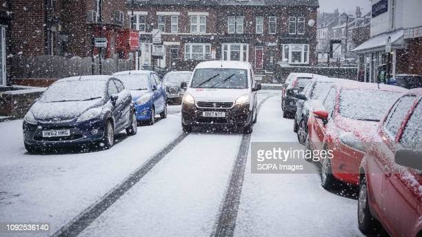 A van seen stopped during a snowfall in Sheffield city center Cold Spell hits the Britain with snow and low temperatures