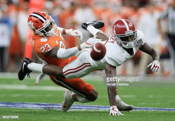 Van Smith of the Clemson Tigers breaks up a pass intended for Calvin Ridley of the Alabama Crimson Tide in the first half of the AllState Sugar Bowl...