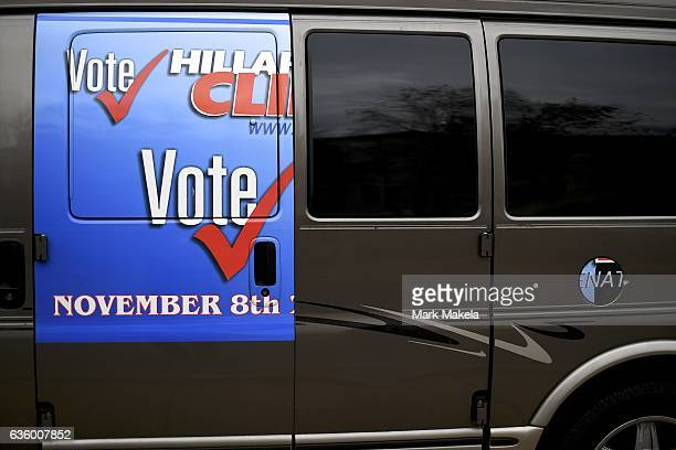 A van still displays fragments of a vote for Hillary Clinton sticker three weeks after election day December 1 2016 in Philadelphia Pennsylvania...