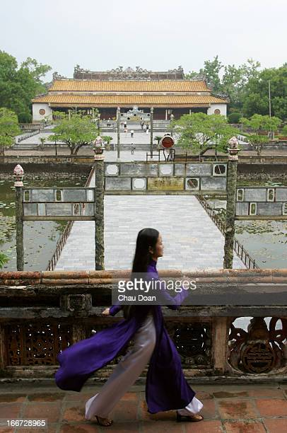Van Thi Anh Tuyet a staff working at the Citadel in Hue walks inside the citadel
