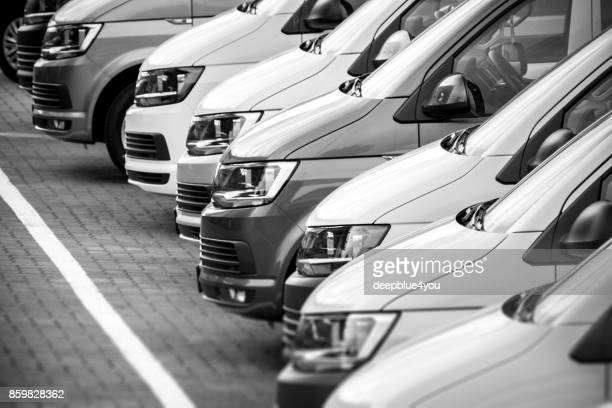 van vehicles at a public place from a car dealer - out of frame stock pictures, royalty-free photos & images