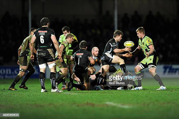GJ van Velze of Northampton Saints receives a yellow card for obstructing Dave Lewis of Exeter Chiefs as he takes a quick tap penalty during the...