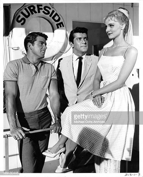 Van Williams and Lee Patterson admiring Diane McBain in a scene from the television series 'Surfside 6' 1960