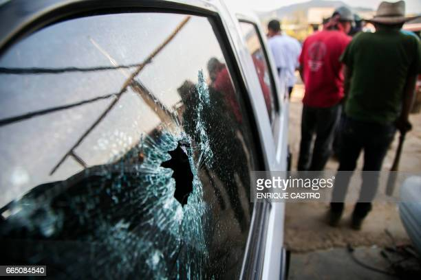 A van with bullet holes is seen following a clash between villagers and state police officers in Arantepacua Nahuatzen municipality Michoacan state...