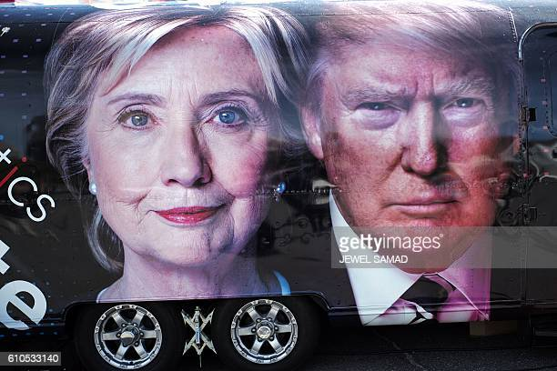 TV van with pictures of both candidates is seen outside the hall where the first presidential debate at Hofstra University's David Mack Sport and...