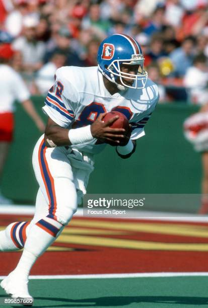 Vance Johnson of the Denver Broncos returns a kickoff against the Kansas City Chiefs during an NFL football game October 27 1985 at Arrowhead Stadium...