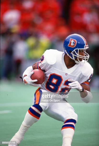 Vance Johnson of the Denver Broncos returns a kickoff against the Kansas City Chiefs during an NFL football game December 27 1992 at Arrowhead...