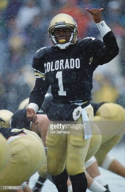 Vance Joseph, Quarterback for the University of Colorado Buffaloes makes a hand signal on the line of scrimmage during the NCAA Big 8 college...