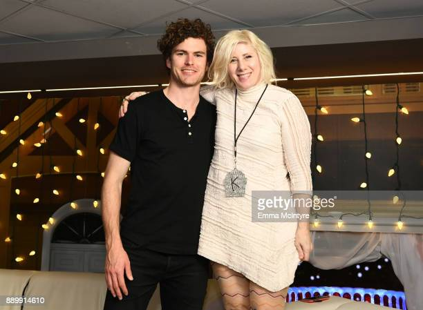 Vance Joy poses with Kat Corbett at KROQ Almost Acoustic Christmas 2017 at The Forum on December 10, 2017 in Inglewood, California.