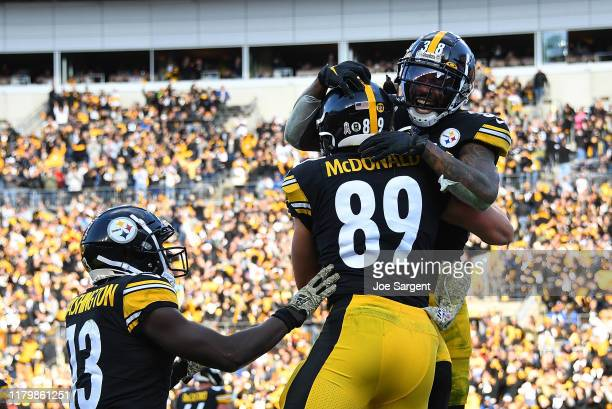 Vance McDonald of the Pittsburgh Steelers celebrates his touchdown with Jaylen Samuels during the third quarter against the Indianapolis Colts at...