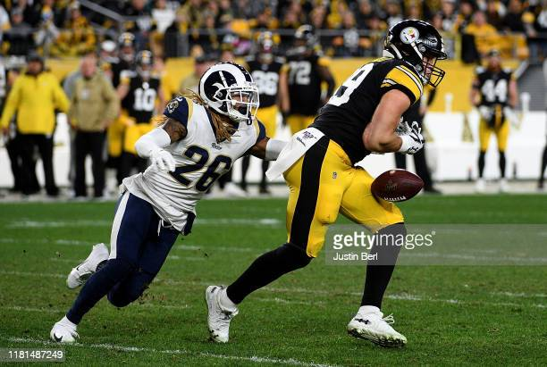 Vance McDonald of the Pittsburgh Steelers drops a pass as Marqui Christian of the Los Angeles Rams defends in the third quarter at Heinz Field on...