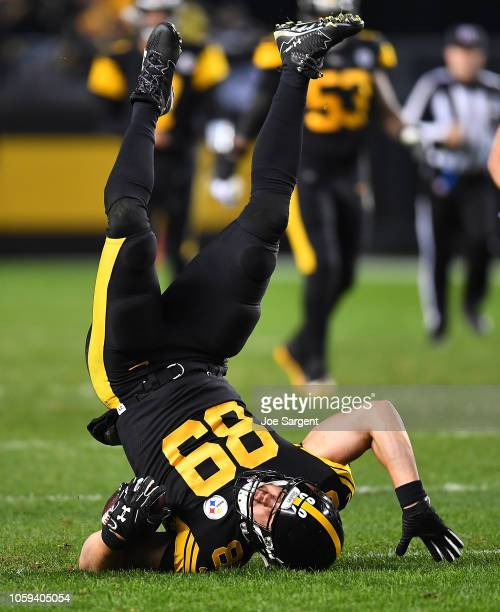 Vance McDonald of the Pittsburgh Steelers is knocked upside down after a catch during the third quarter in the game against the Carolina Panthers at...