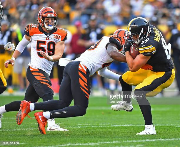 Vance McDonald of the Pittsburgh Steelers is wrapped up for a tackle by George Iloka of the Cincinnati Bengals in the first half during the game at...