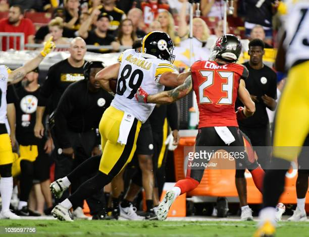 Vance McDonald of the Pittsburgh Steelers runs in a touchdown against the Tampa Bay Buccaneers in the first quarter on September 24 2018 at Raymond...