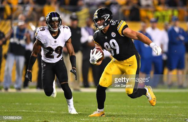 Vance McDonald of the Pittsburgh Steelers runs upfield after a catch in the second quarter during the game against the Baltimore Ravens at Heinz...