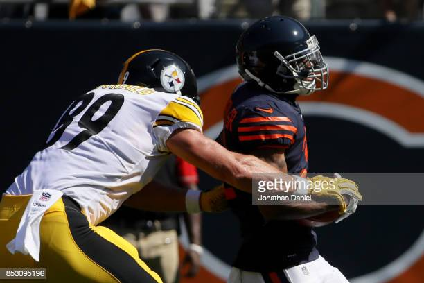 Vance McDonald of the Pittsburgh Steelers strips the ball from Marcus Cooper of the Chicago Bears resulting in a fumble in the second quarter at...