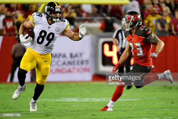 Vance McDonald of the Pittsburgh Steelers takes on Chris Conte of the Tampa Bay Buccaneers in the first quarter on September 24 2018 at Raymond James...