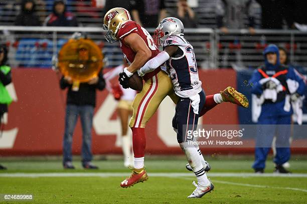 Vance McDonald of the San Francisco 49ers catches an 18yard touchdown pass against the New England Patriots during their NFL game at Levi's Stadium...