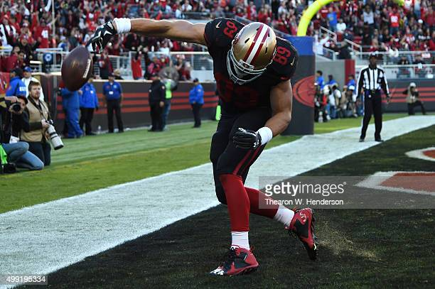 Vance McDonald of the San Francisco 49ers celebrates after scoring a touchdown on an eightyard pass against the Arizona Cardinals during their NFL...