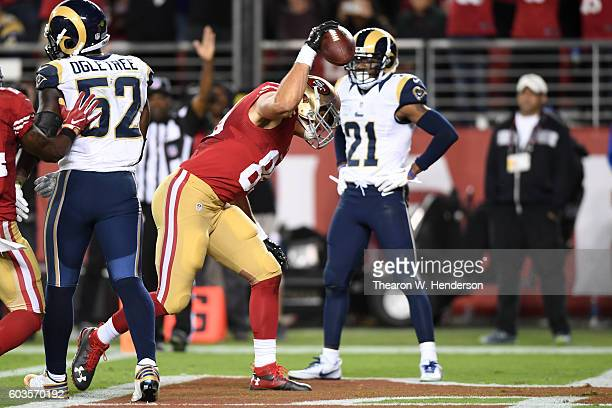 Vance McDonald of the San Francisco 49ers celebrates after scoring in the fourth quarter of their NFL game against the Los Angeles Rams at Levi's...