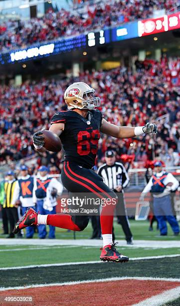 Vance McDonald of the San Francisco 49ers celebrates after scoring on an 8yard touchdown reception during the game against the Arizona Cardinals at...