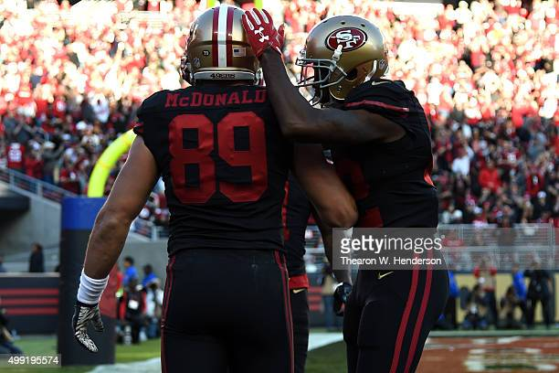 Vance McDonald of the San Francisco 49ers celebrates with Torrey Smith after scoring a touchdown on an eightyard pass against the Arizona Cardinals...