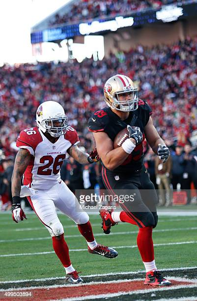 Vance McDonald of the San Francisco 49ers heads to the end zone on an 8yard touchdown reception during the game against the Arizona Cardinals at Levi...