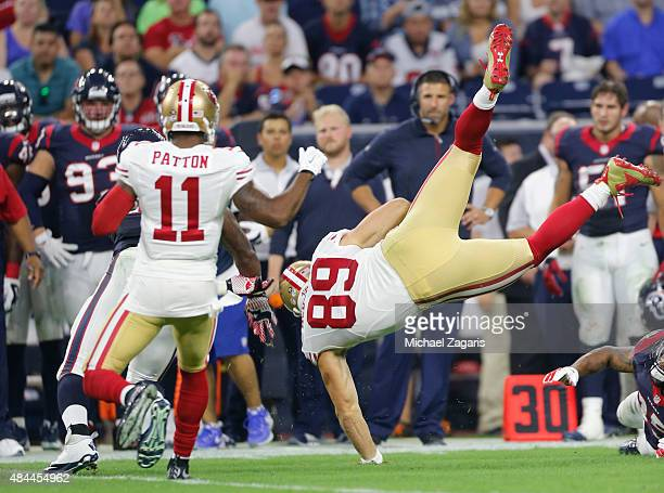 Vance McDonald of the San Francisco 49ers is upended after making a reception during the game against the Houston Texans at NRG Stadium on August 15...