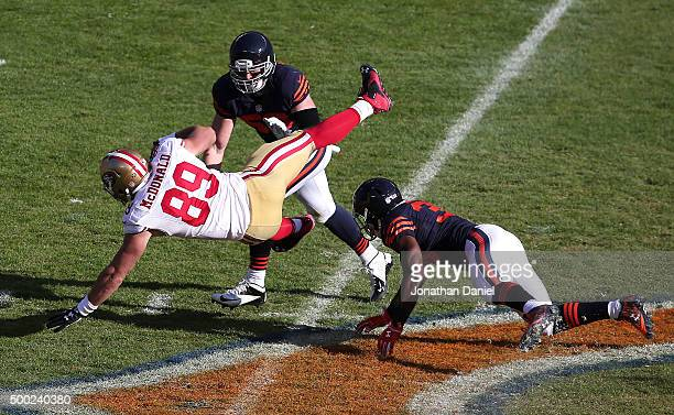 Vance McDonald of the San Francisco 49ers is upended by Adrian Amos of the Chicago Bears at Soldier Field on December 6 2015 in Chicago Illinois The...