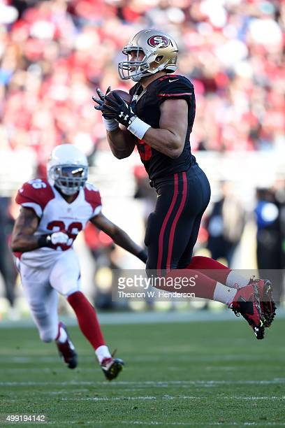 Vance McDonald of the San Francisco 49ers makes a catch against the Arizona Cardinals during their NFL game at Levi's Stadium on November 29 2015 in...