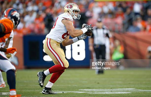 Vance McDonald of the San Francisco 49ers makes a reception during the game against the Denver Broncos at Sports Authority Field on August 20 2016 in...