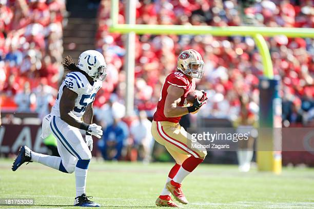 Vance McDonald of the San Francisco 49ers runs after making a reception during the game against the Indianapolis Colts at Candlestick Park on...