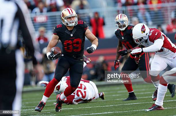 Vance McDonald of the San Francisco 49ers runs after making a reception during the game against the Arizona Cardinals at Levi Stadium on November 29...