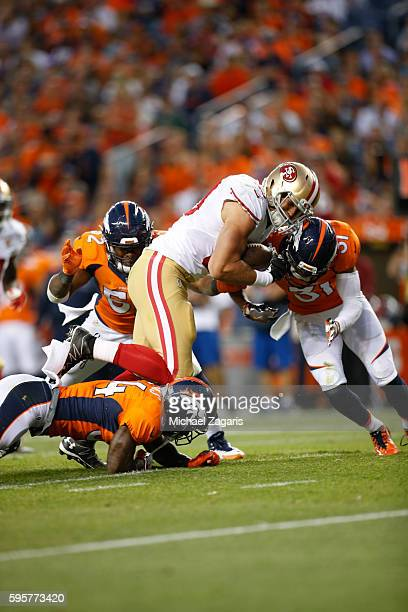 Vance McDonald of the San Francisco 49ers runs after making a reception during the game against the Denver Broncos at Sports Authority Field on...
