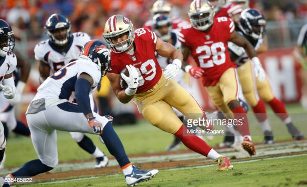 Vance McDonald of the San Francisco 49ers runs after making a reception during the game against the Denver Broncos at Levi Stadium on August 19 2017...
