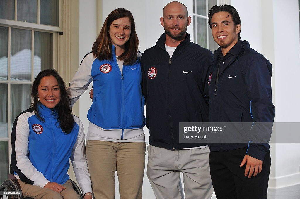 Vancouver 2010 United States Paralympian Alana Nichols, Olympian Katherine Reutter, Paralympian Heath Calhoun and Olympian Apolo Ohno pose for a photo after speaking to reporters outside the West Wing of the White House on April 21, 2010 in Washington, DC.