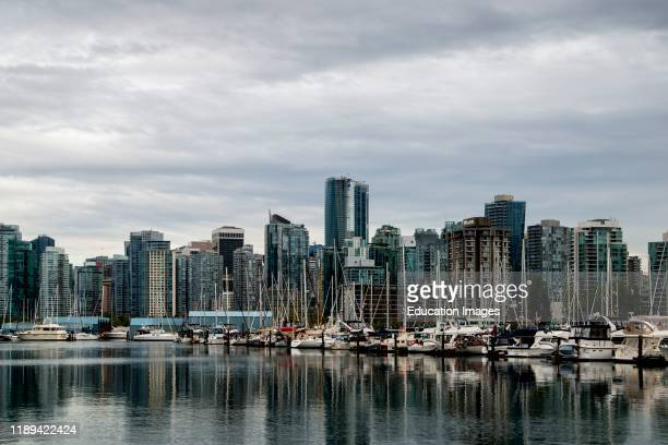 Vancouver British Columbia Canada City skyline showing Vancouver harbor with sailboats