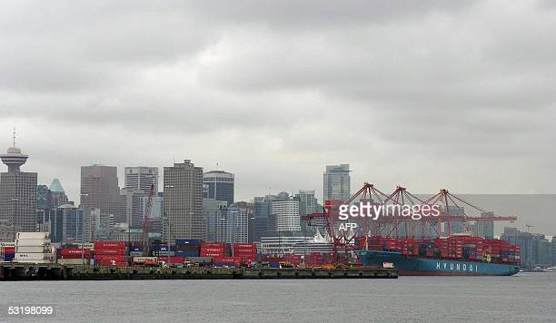A container ship unloads 01 July 2005 at the PO Central Terminal in the Port of Vancouver one of North America's most important gateways to Asia...