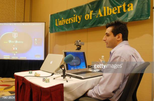 Ali Eslami plays poker in the First ManMachine Poker Championship at the Association for the Advancement of Artificial Intelligence Conference 23...