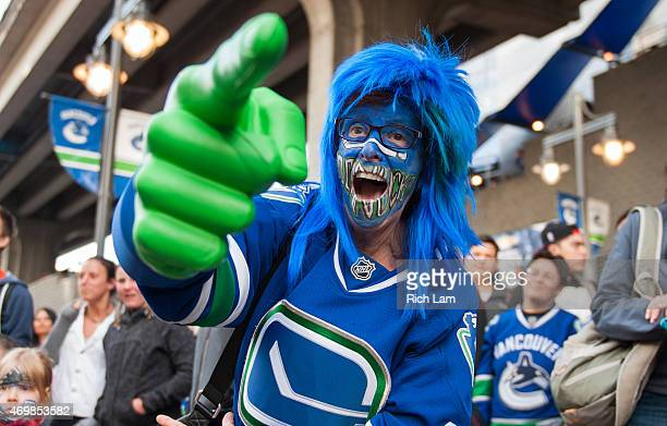 Vancouver Canuck fan celebrates outside prior to the start of Game One of the Western Conference Quarterfinals between the Calgary Flames and the...