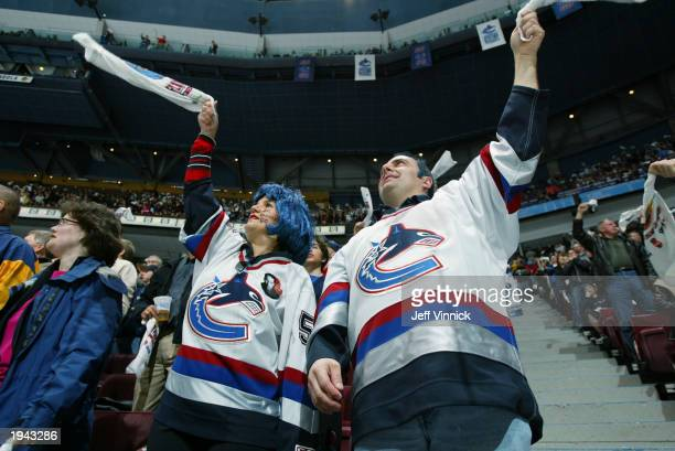 Vancouver Canuck fans cheer on their team during the game against the St. Louis Blues during the first round of the 2003 Stanley Cup playoffs at...