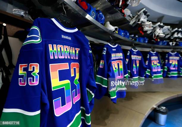 Vancouver Canuck jerseys sport Pride colours before their NHL game against the Detroit Red Wings on You Can Play Night at Rogers Arena February 28...