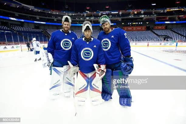Vancouver Canucks backup goaltender Zehao Sun poses for a photo with Jacob Markstrom and Anders Nilsson during their gameday skate at MercedesBenz...