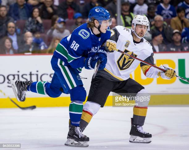 Vancouver Canucks Center Adam Gaudette battles with Vegas Golden Knights Left Wing Tomas Tatar during the first period in a NHL hockey game on April...