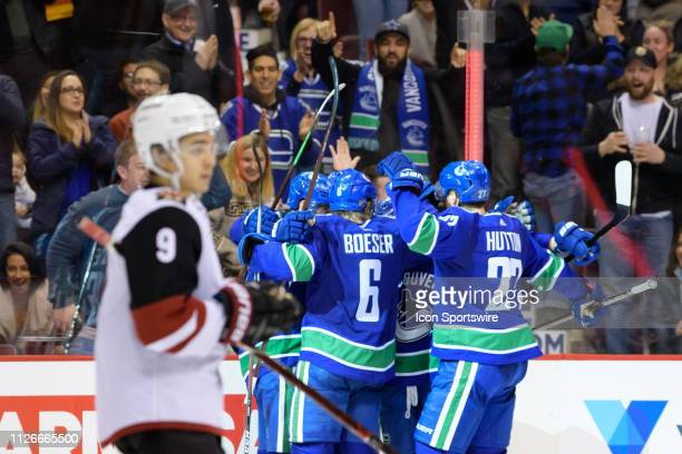 Vancouver Canucks Center Adam Gaudette celebrates with Left Wing Antoine Roussel Right wing Brock Boeser Defenseman Ben Hutton and Defenseman Troy...