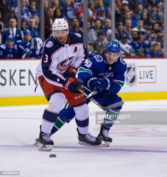 VANCOUVER BC MARCH 31 Vancouver Canucks Center Adam Gaudette checks Columbus Blue Jackets Defenceman Seth Jones during the third period in a NHL...