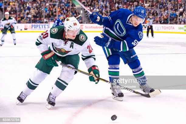 Vancouver Canucks Center Bo Horvat and Minnesota Wild Defenceman Ryan Suter battle for the puck during their NHL game at Rogers Arena on February 4...