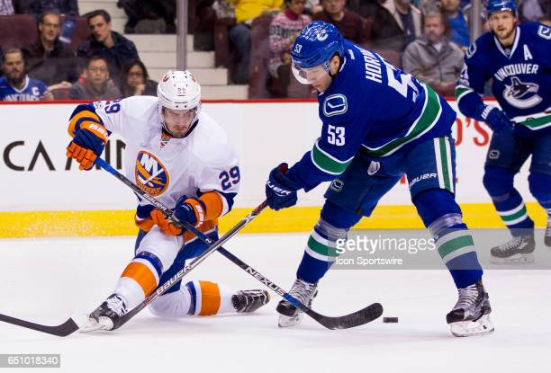 Vancouver Canucks Center Bo Horvat checks New York Islanders Center Brock Nelson during a NHL hockey game on March 09 at Rogers Arena in Vancouver,...