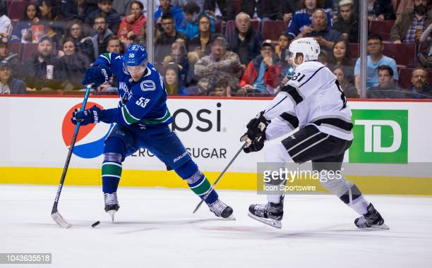 Vancouver Canucks center Bo Horvat handles the puck against the Los Angeles Kings in a NHL hockey game on September 20 at Rogers Arena in Vancouver BC